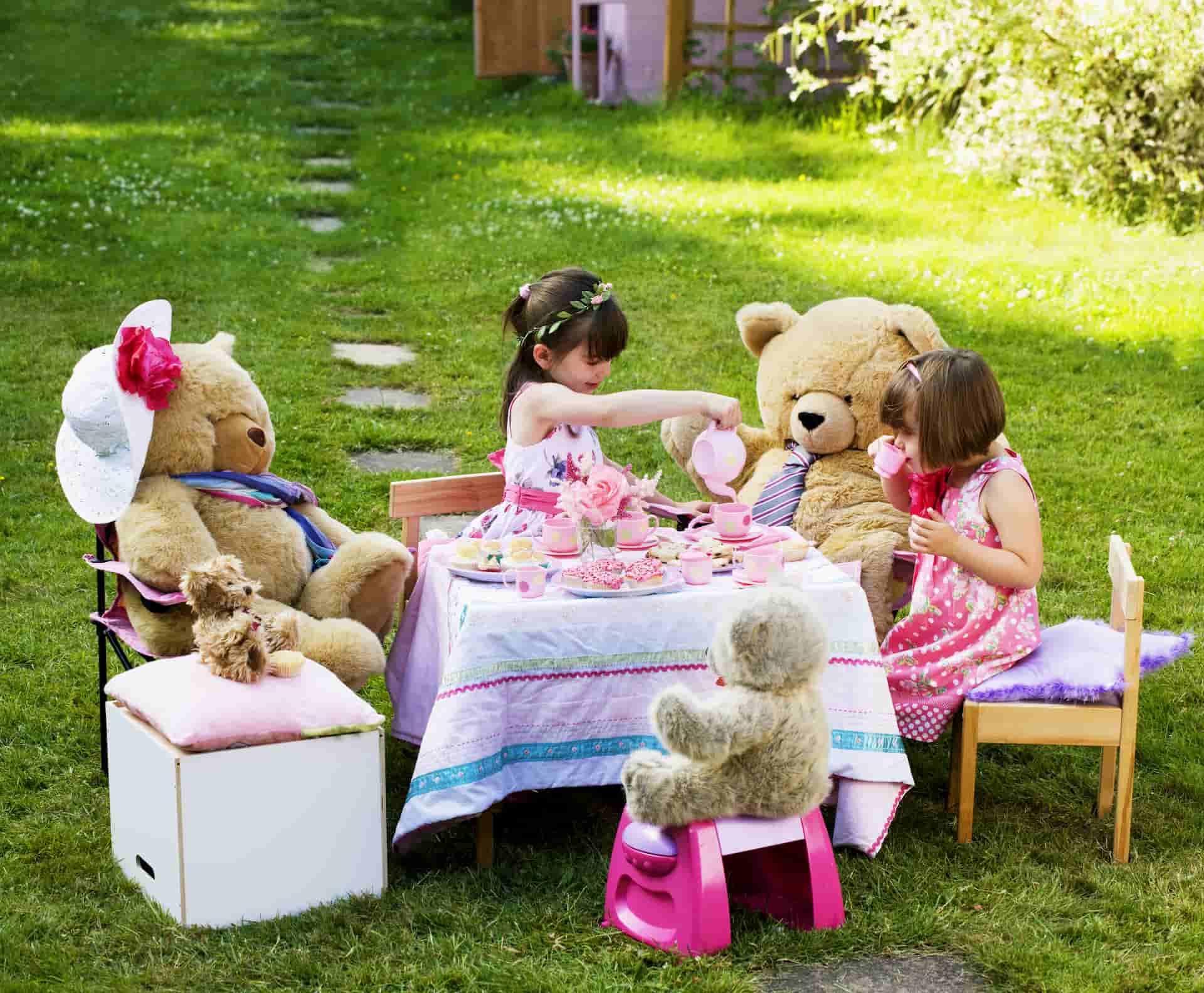 young girls having a teddy bear picnic