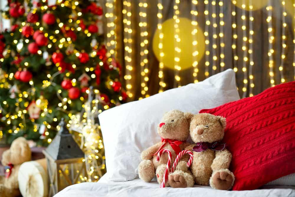 christmas living room with teddies on a sofa